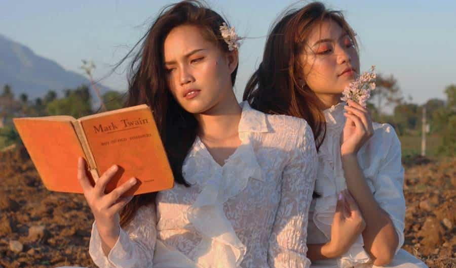 Photo Session of Sisters with Books