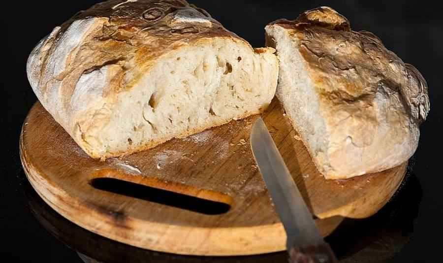 Freshly Baked Bread Wouldn't Look So Delicious Without A Board and A Knife As A Prop.