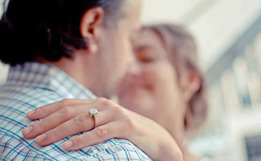 Joint Photo of Couple with Engagement Ring